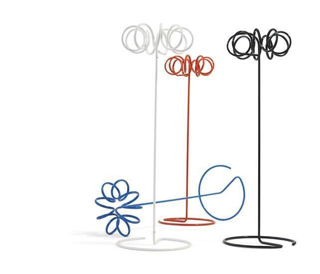 Staffan Holm's VISP coat rack designed for Blastation is a piquant accent in any room. Coiled tubular steel coils grounded by plastic feet offer floor-friendly, lightweight storage space.  Coat Stands for the Modern Home  by Jacqueline Leahy
