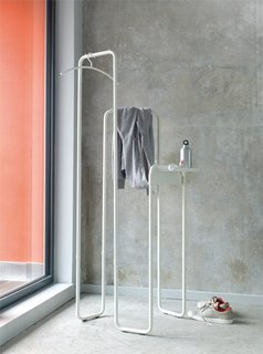 The SPIN coat stand, designed by Sutdio Taschide and produced by schonbuch is portable, its metal tubes fold flat for storage, and with its accessory shelves, it does more than stand around looking pretty.