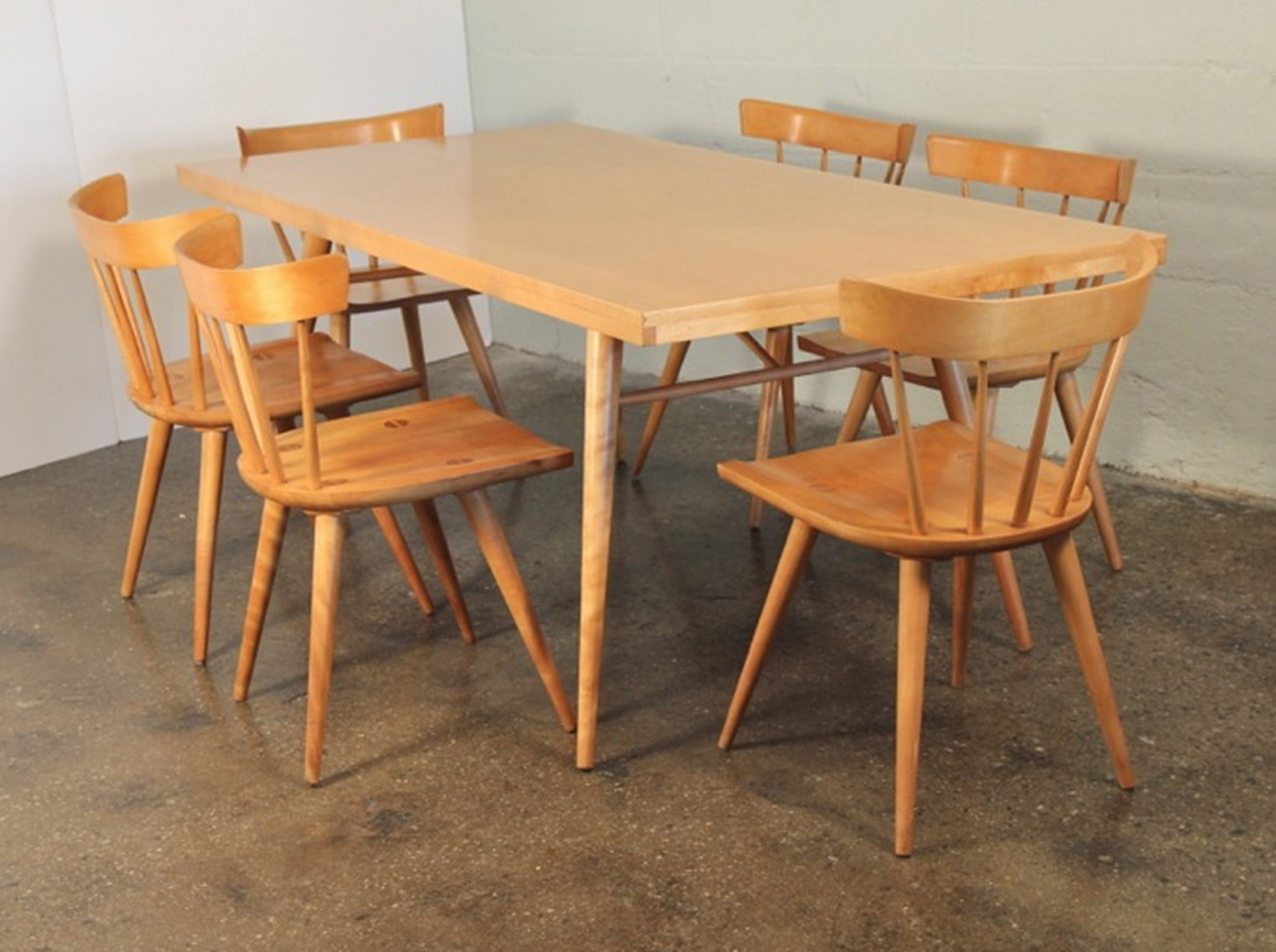 """Paul McCobb dining set: """"Super versatile; the chairs look great mixed-and-matched with other styles, and the table kills with Eames chairs. A call back to early American Shaker furniture. Just as well-built, too."""" See more Paul McCobb furniture at Open Air Modern.  Photo 9 of 11 in Must-Have Collectors Items at Brooklyn's Open Air Modern"""
