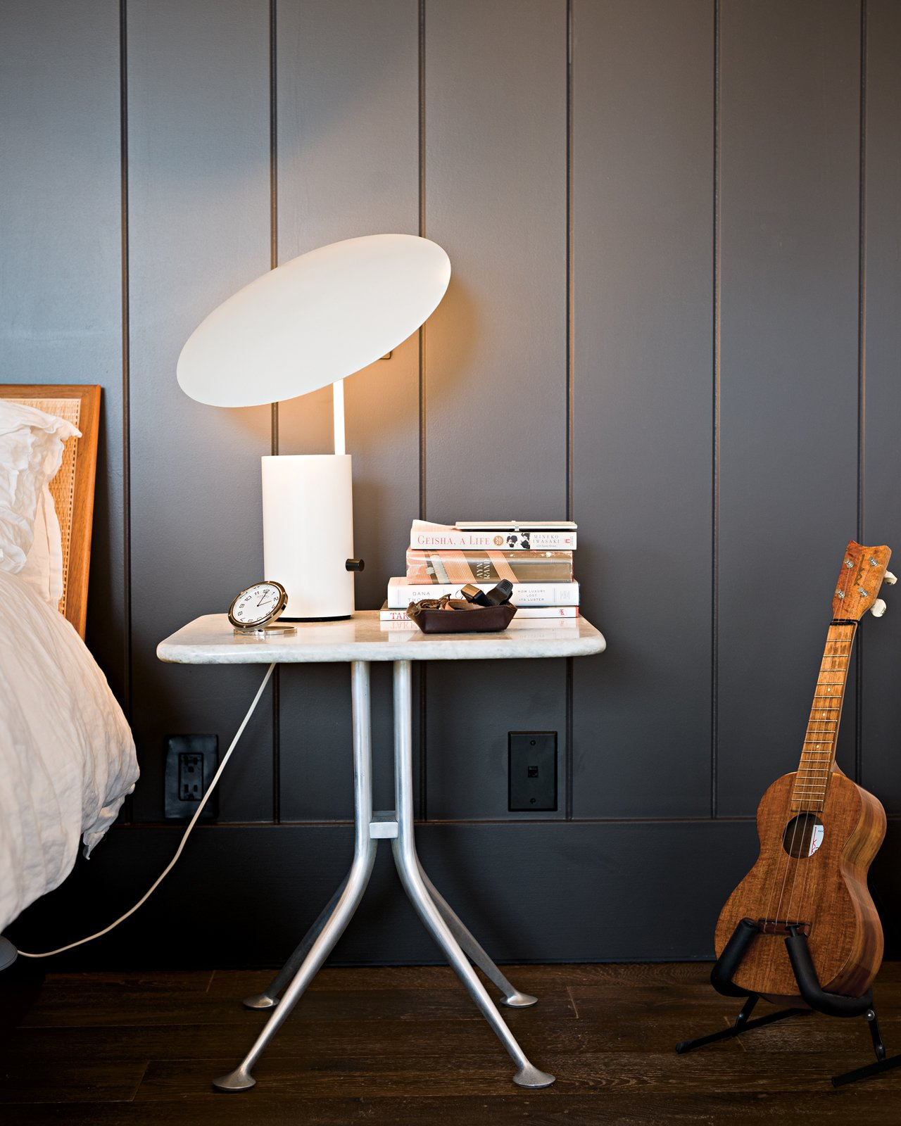 "Bedroom, Night Stands, Table Lighting, and Dark Hardwood Floor More prized possessions that made the cut: A George Nelson Half-Nelson lamp sits atop an Alexander Girard bedside table.  Search ""george-smart.html"" from Less is More in this Manhattan Beach Bungalow"