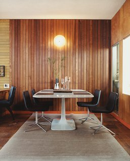In 2005, Gretchen Rice and Kevin Farnham acquired a 1908 home in San Francisco that had been remodeled in the 1940s by well-known local architect Henry Hill. Their series of small interventions have kept the design intent of the 1940s renovation—including an enclosed atrium, wood wall paneling, and unusual built-ins—while updating the home for contemporary living. In the dining area, Metropolitan side chairs by Jeffrey Bernett for B&B Italia surround a Surf Table designed by Carlo Colombo for Zanotta.