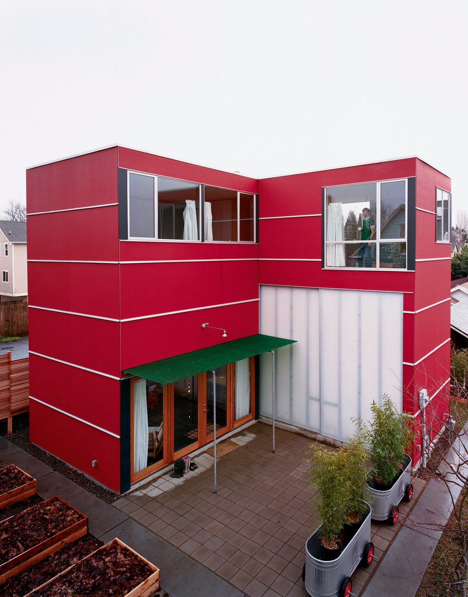 Outdoor, Concrete Patio, Porch, Deck, and Small Patio, Porch, Deck Seattle  David Sarti's little red house in Seattle's sleepy Central District proves that a bit of land, ambition, and carpentry know-how can go a long way. The rear facade. Photo by Misha Gravenor.  Radical Red Houses by Erika Heet from Seattle vs. Denver Mashup
