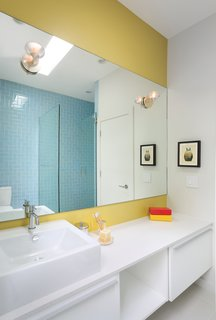 Benjamin Moore's Mustard Field paint adds a vibrant touch to another bathroom in the house.