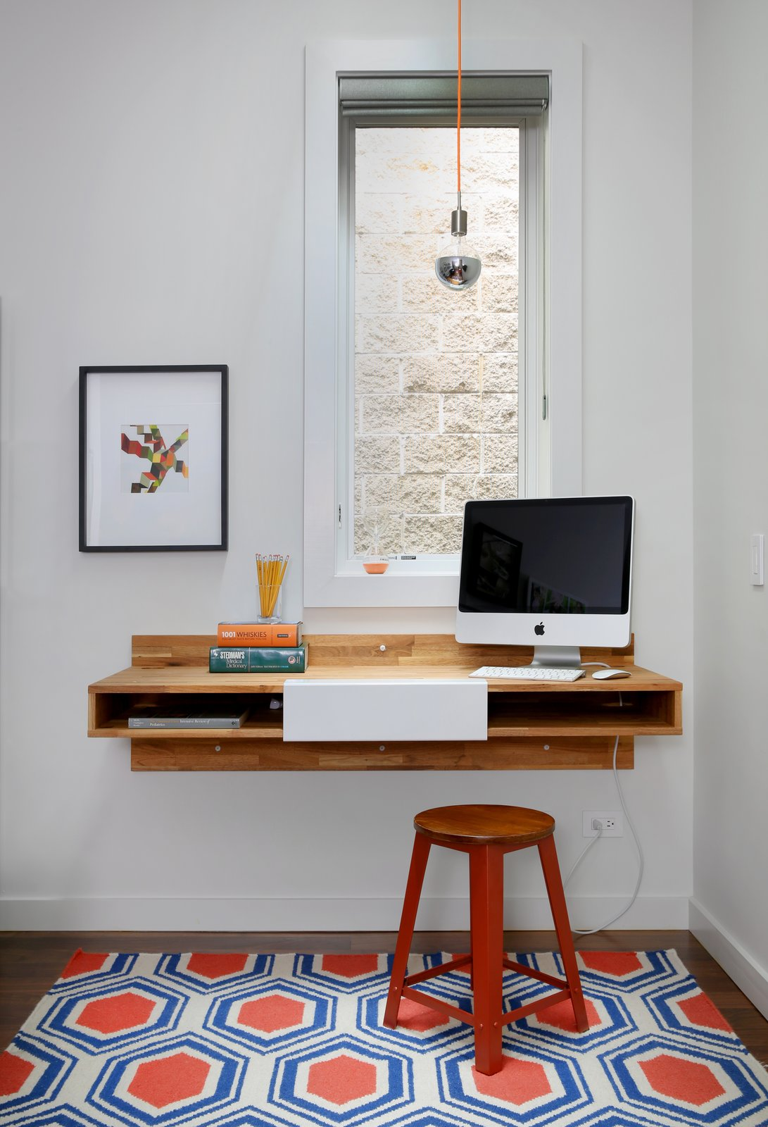 Office, Study Room Type, Desk, Rug Floor, and Dark Hardwood Floor A Mash Studio Wall-Mounted desk offers a place to study. The rug is from One King's Lane and a SoCo Modern Socket pendant illuminates the room.  Lakeview by Diana Budds