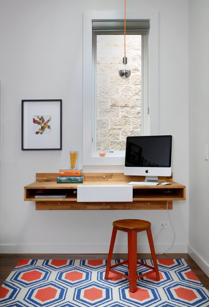 A Mash Studio wall-mounted desk offers a place to study in this Chicago family home.