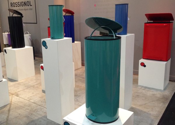 "Frédéric Perigot designed this trash bin with ""the body of an aircraft,"" ""a lid like a Frisbee,"" and a lid that closes with the ""feel of a sedan."" Which fulfills most, if not all, of our ideal trash can requirements. It's not cheap, but it will last forever. The round Frisbee version is €298; the larger, rectangular Mobil version with two canisters on the interior is €598."