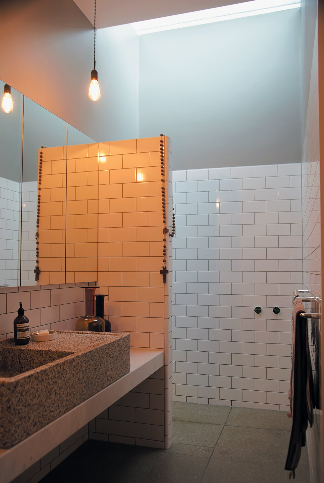 Gorman and Angelucci make use of the en suite master bathroom that sits just behind their inexpensive walk-in closet with messmate facing.  Photo 9 of 9 in 1860s Stable Modernized in Melbourne