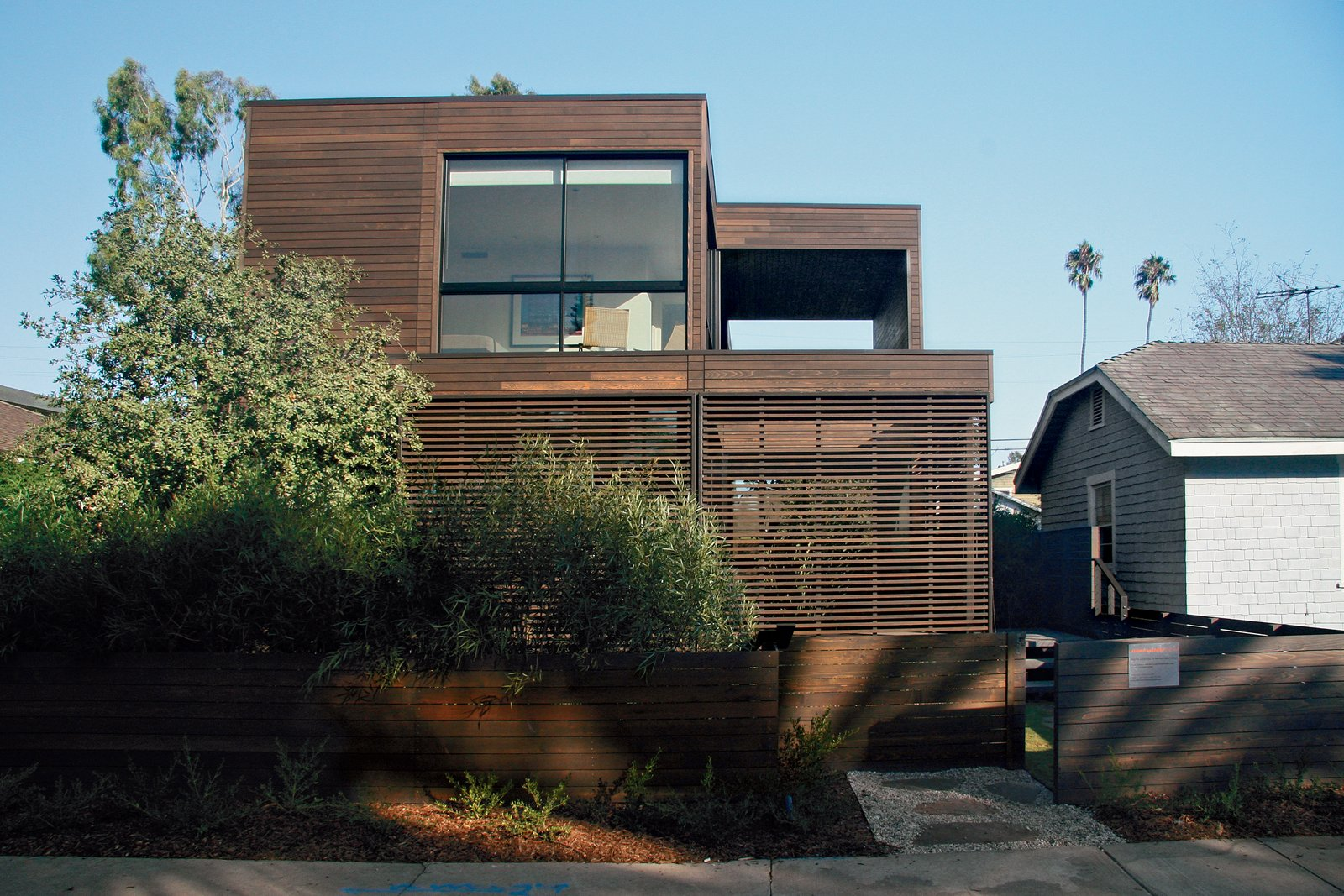 Wood cladding skins the facade of a completed Marmol Radziner Prefab home in Venice, California.  Marmol Radziner Prefab by Jessica Hundley from Pristine Prefabs from Marmol Radziner