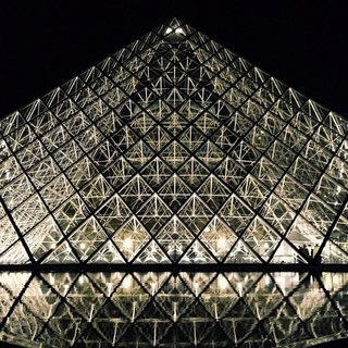 The Louvre Pyramid by I.M.Pei, installed in 1998. Quite stunning at night!