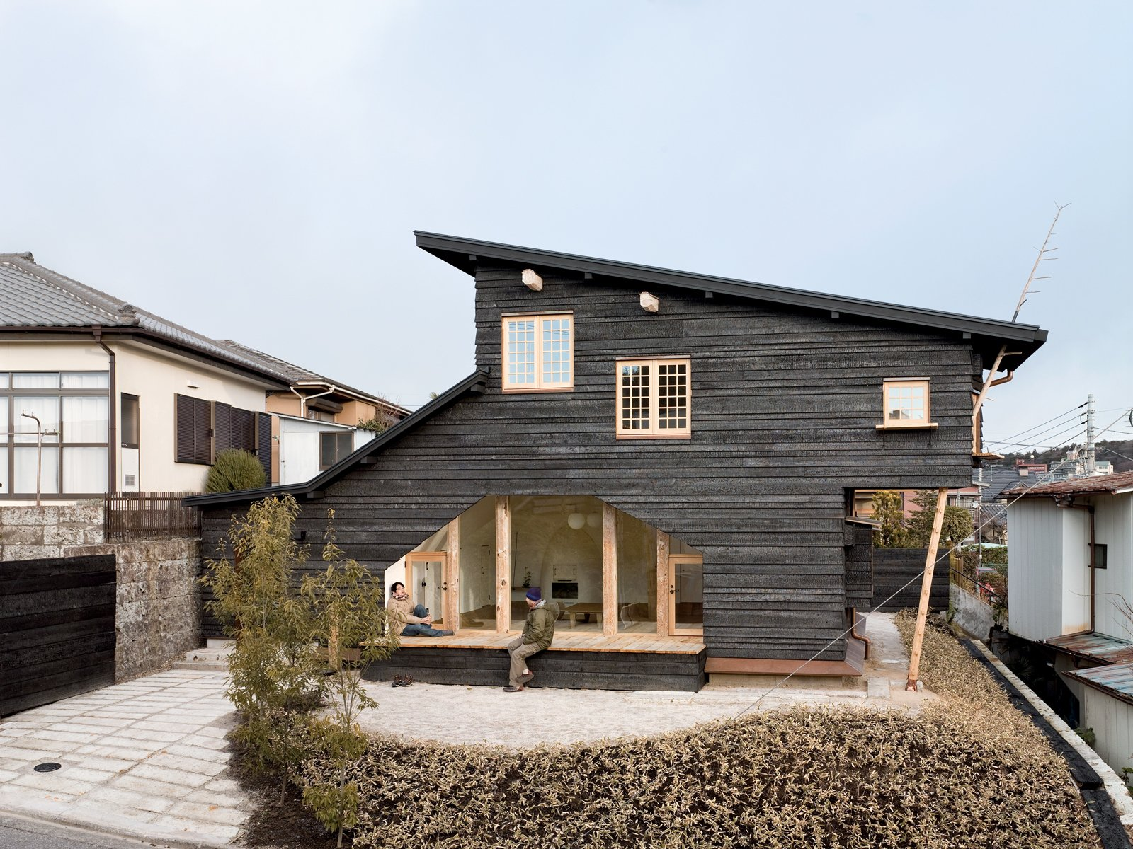 In Fujimori's most recent project, Coal House, a tearoom protrudes from the second story, accessible from the exterior by a timber ladder that appears to pierce the roof and from the interior by a secret door in the master bedroom.  Photo 12 of 23 in Terunobu Fujimori