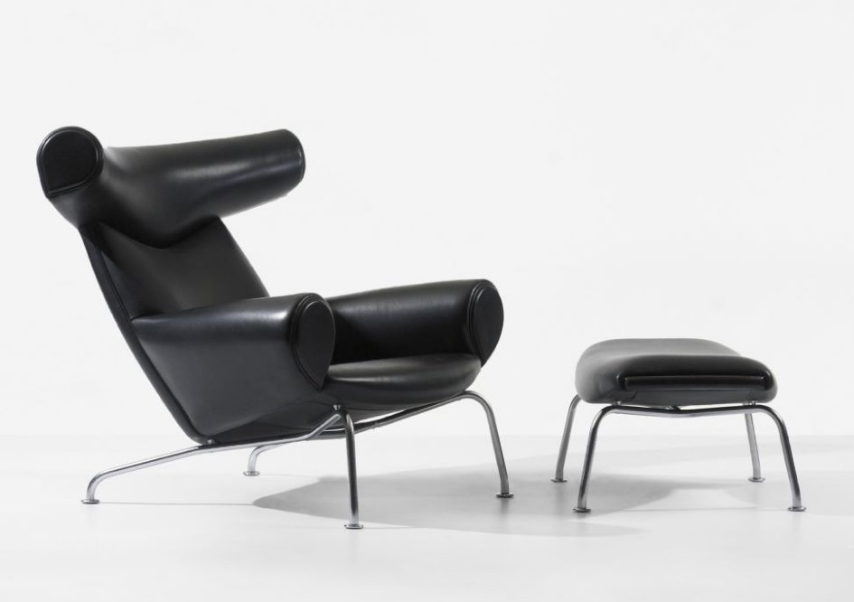 """Often referred to as one of the designer's favorite pieces, the leather Ox chair (1960), perched on chromed steel supports, shows modern design doesn't always need to be so """"dreadfully serious."""" The inflated shapes of Picasso's paintings supposedly inspired the shape of this piece, which -- true to form if you're taking Surrealism as a reference point -- initially were sold with or without horns.  Photo 7 of 9 in 8 Iconic Chairs by Hans Wegner"""