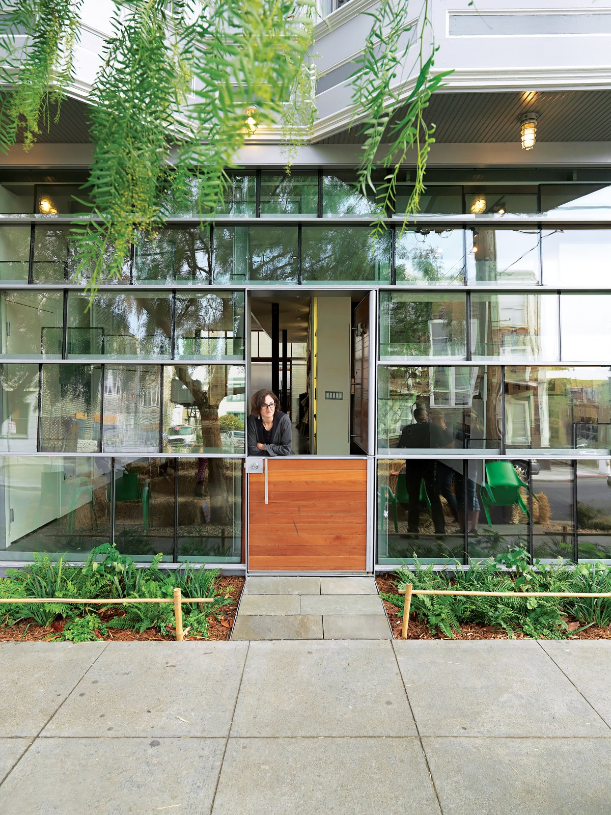 Doors, Exterior, Wood, and Swing Door Type Dunbar and Astrakhan's low-cost, high-impact tour de force is a storefront facade constructed from salvaged double-insulated window glass panels arranged in a shingle pattern.  Best Photos from Just Redo It