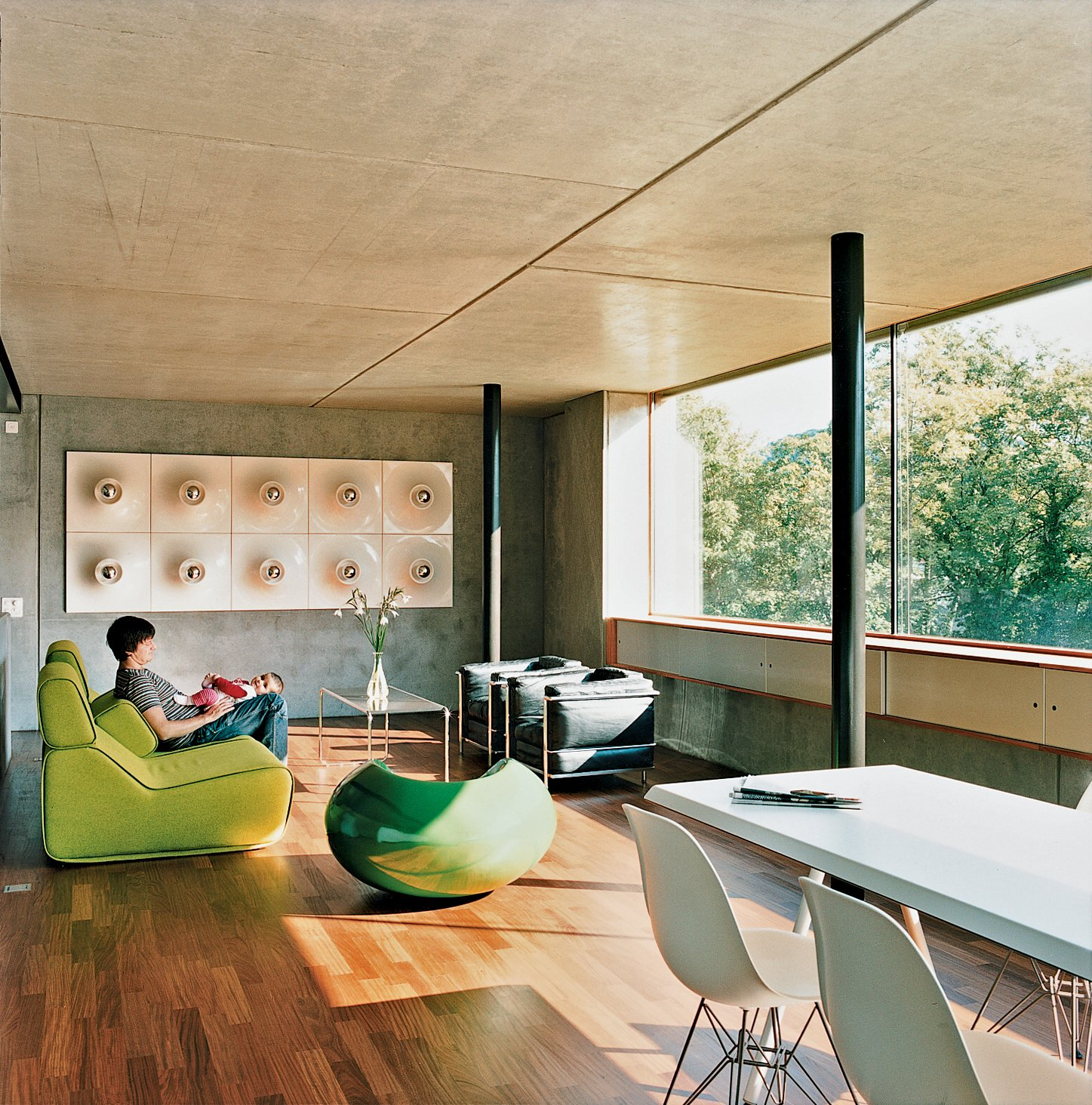 """Living Room, Sofa, Chair, Medium Hardwood Floor, and Coffee Tables Meili and Anais lounge on a Transform sofa by Moroso.  Search """"officefloors--concrete"""" from Swiss Mix"""