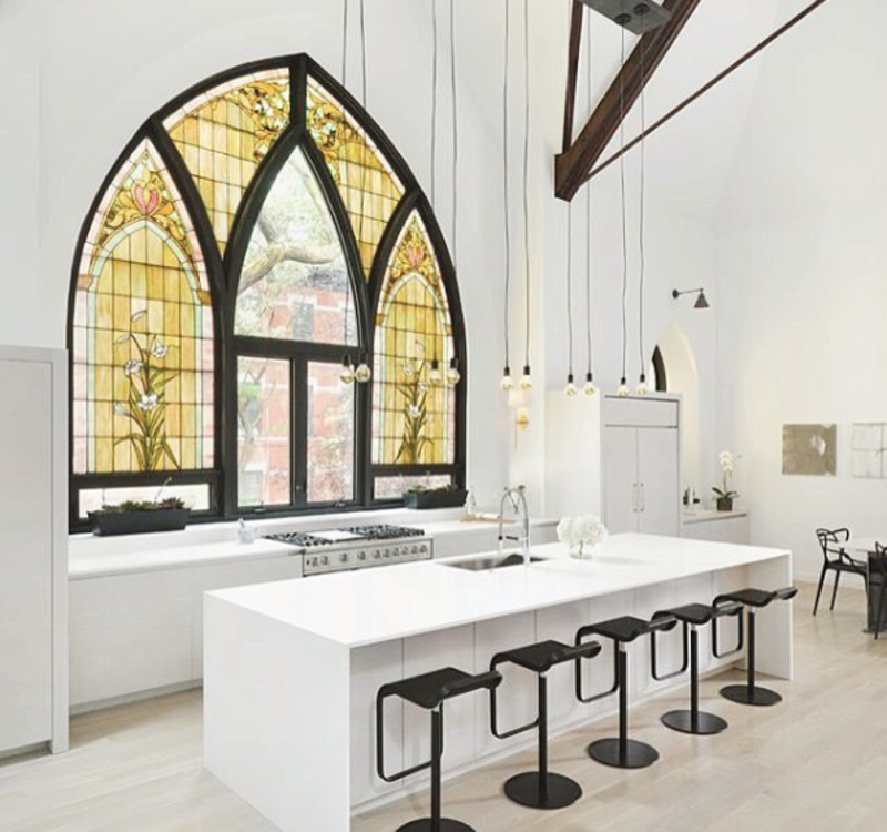 This home in a former Chicago church fully utilizes an original stained-glass window in its light-filled kitchen.  Heavenly Converted Churches by William Harrison from Photo of the Week: Family Home in an Old Converted Church