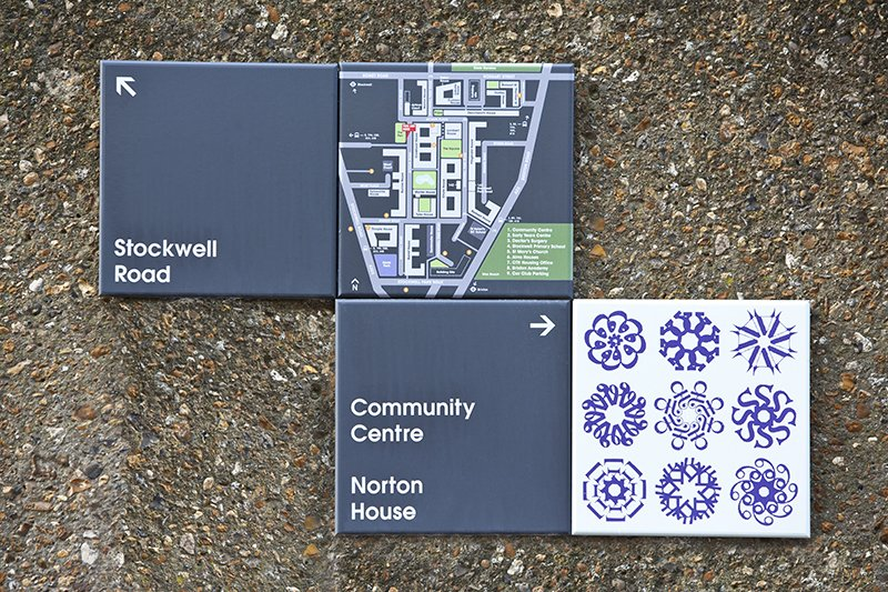 Wynter House signage, tile designed by Linda Florence. Photo by hat-trick design.  Photo 7 of 7 in Projectile Motion: Hat-Trick Design's Stockwell Project Bring Local Art to Wayfinding