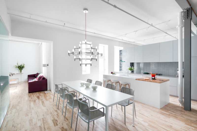 In a 1920s building on St-Dominique Street in Montreal, formerly a factory for canned soup, a sleek apartment for a family now stands.  Luminous Modern Apartment in an Industrial Montreal Building by Allie Weiss from Bright, Light-Filled Renovations