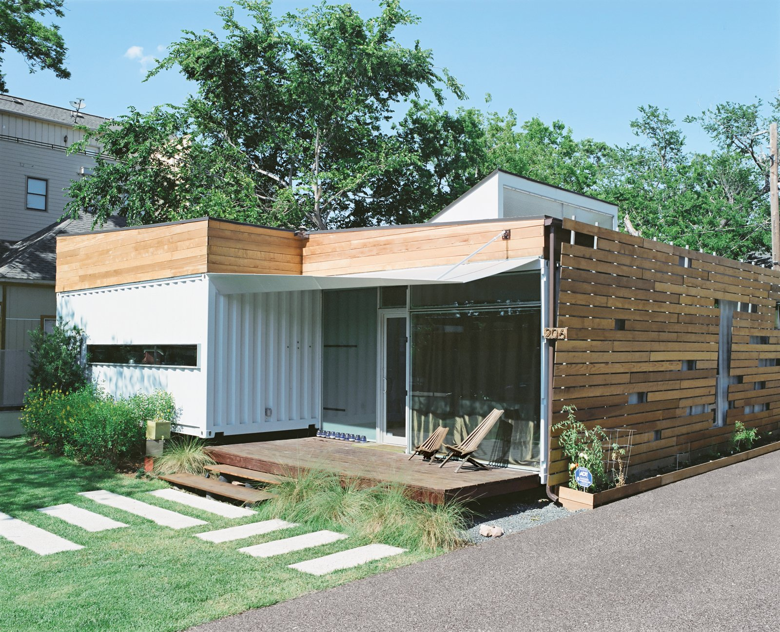 Exterior, Shipping Container Building Type, Wood Siding Material, and Metal Siding Material To the right of the house, the couple had a Geosystems FilterPave porous pavement driveway installed. Made of post-consumer recycled glass, the driveway lets water pass through it at an astonishing speed and, in the sun, adds a little sparkle.  Shipping Containers by Dwell from The Shipping Muse