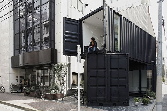 CC4441 (Tokyo, Japan)  Tomokazu Hayakawa sliced and stacked two black containers to create an angular art gallery and office space in the Taito district.  Photo by Kuniaki Sasage  Shipping Containers by Dwell from Examples of Shipping Container Architecture