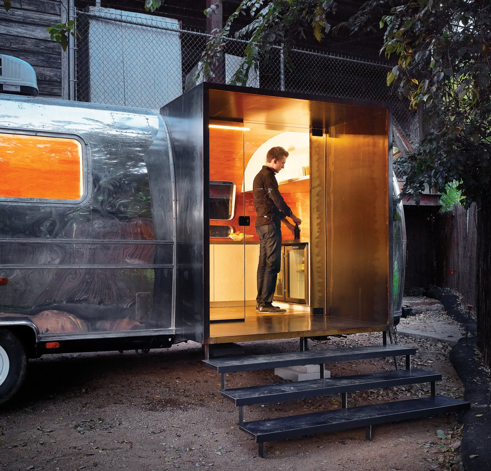 """Exterior, Airstream Building Type, and Metal Siding Material With a last minute deadline, architect Burton Baldridge transformed a decaying trailer into a modern green home for Stubb's, an Austin, Texas club. Baldridge teamed up with Branson Fustes of Pilgrim Building Company to work on the interiors and building custom furniture, such as a bar on one end.  Search """"trailers"""" from Trailer Flash"""