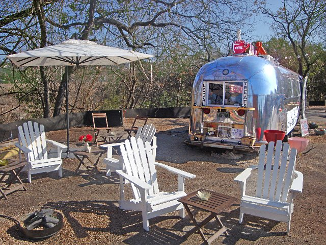 Lauren Dolinsky's petite flower shop is cozily housed in a renovated Airstream she found on Craigslist.  Reasons to Love Austin, Texas by Erika Heet from LD Design: Botanical Design in an Austin Airstream