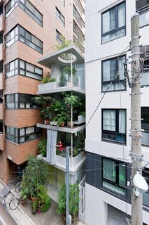 A series of open, street-facing gardens make up this five-story, 700-square-foot home in Tokyo, Japan. Called Garden & House, it was designed by Ryue Nishizawa, and serves as part of a study of new urban lifestyles for the non-nuclear family.