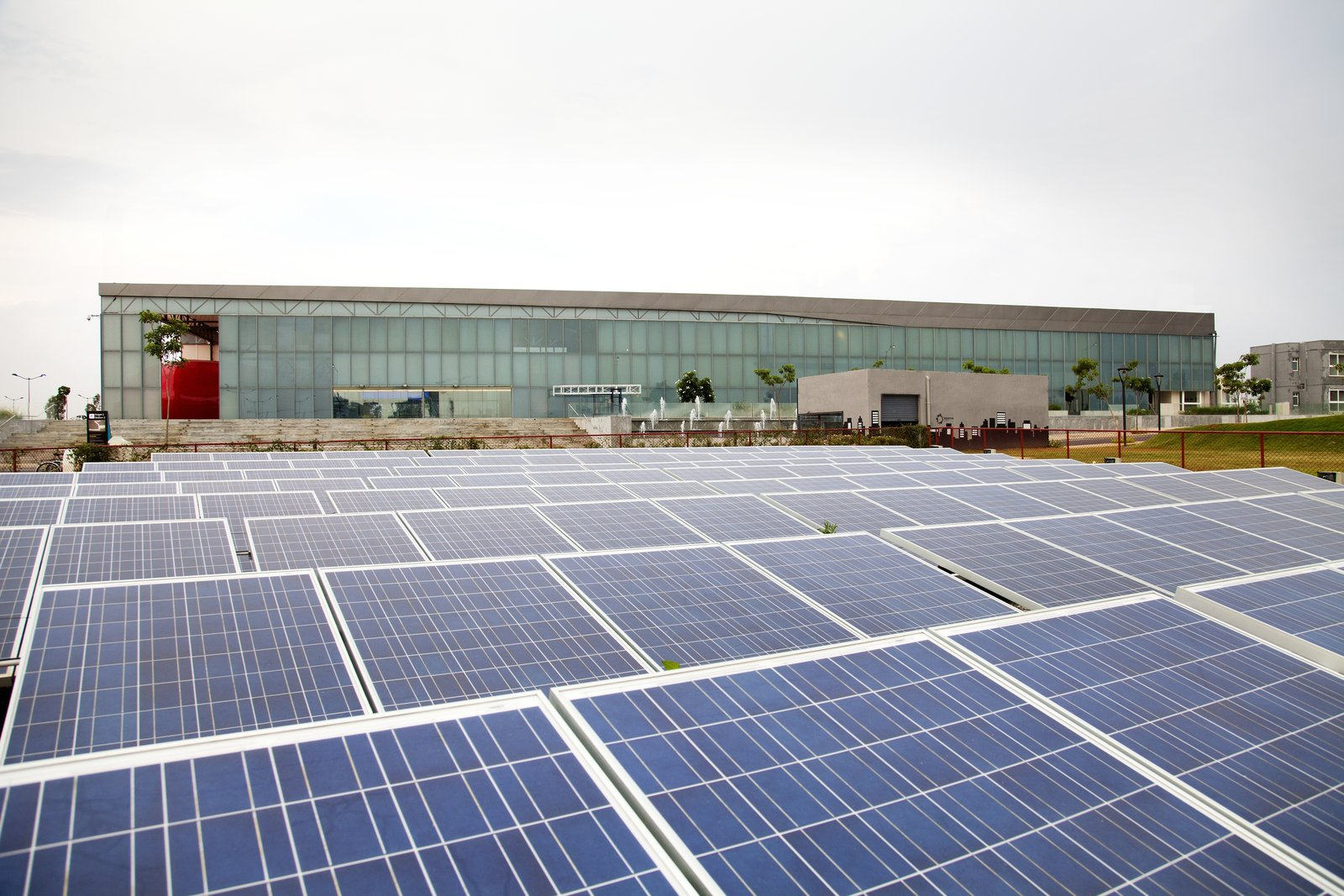 An expanse of solar panels powers the building, which was designed to be easily deconstructed and moved in a few years' time.  Photo 6 of 7 in A Modern Town Hall in Bangalore