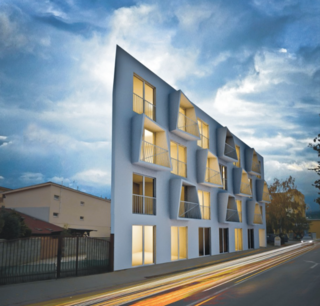 Situated in Senec, a suburb of Bratislava and a popular summer destination, North Star Rising is a starkly iconic building. Jutting up into the sky, its nearly triangular design realizes the architectural possibilities of a somewhat oddly-shaped urban lot.