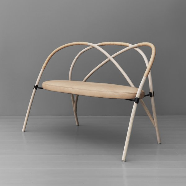 Gemla is the Swedish factory that's been bending wood since the late 1800s.  So how do you create a contemporary sofa out of bent wood? Lisa Hilland did it with as few components as possible; three overlapping arches wrapped in leather for a tactile touch.