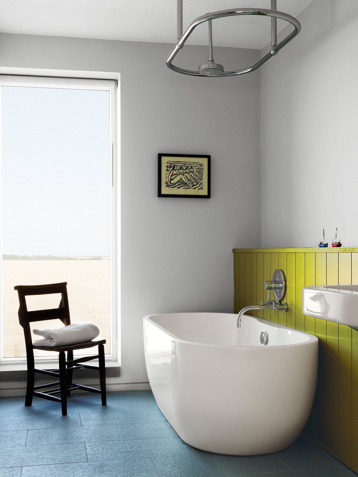 "Bath Room, Freestanding Tub, and Soaking Tub A Lisbon freestanding tub and ""a church chair from a junk shop"" complete the children's bathroom.  Ways to Use Color at Home by Diana Budds from Centuries-Old Farmhouses Inspired This Timeless Home"