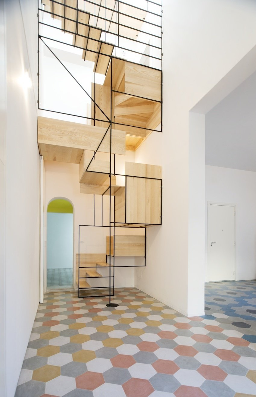 Staircase, Wood Tread, and Metal Railing Architect Francesco Librizzi built the staircase for the Casa G project as a means to slow the ascent, to create stations that infused the interior with life.  190+ Best Modern Staircase Ideas
