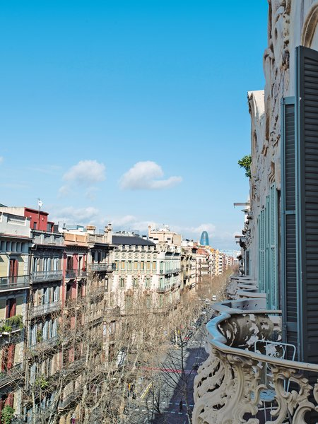In 1910, when the building was constructed, Barcelona's economy was booming and, as a result, so were the arts. Architecture was especially popular among the city's wealthier citizens, and splendid buildings were built in the new neighborhood of L'Eixample, on the edge of the old, Gothic city center.