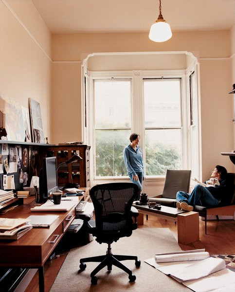 """Her office is filled with refurbished finds and originals—–like her updated take on a '60s-style desk and """"slouch"""" chairs, from which she chats with her partner, Katherine Catlos."""