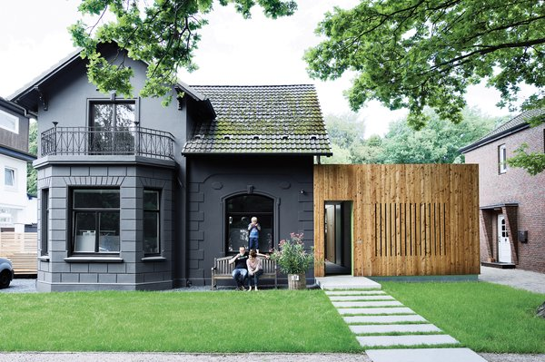 A family in Hamburg, Germany, turned a kitschy turn-of-the-century villa into a high-design home with a few exterior tricks, including sheathing the exterior in one-dimensional, murdered-out black.