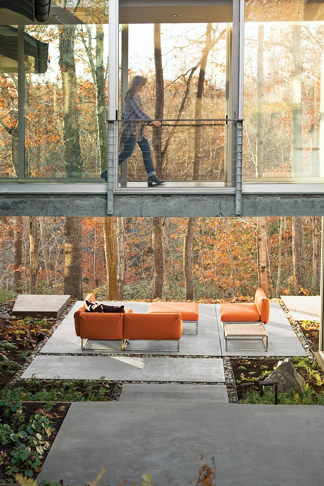 "Outdoor, Concrete Patio, Porch, Deck, Large Patio, Porch, Deck, and Back Yard In fall, the color of this backyard in Charlottesville, Virginia, changes daily with the foliage. Elizabeth Birdsall marvels how new outdoor spaces on her property, like a patio furnished with upholstered seating from Gloster, make enjoying the woods an easy experience: ""It's like comfortable camping, all the time.""  Backyard Daydream from How This Landscape Design Made a Home as Fun as a Playground"