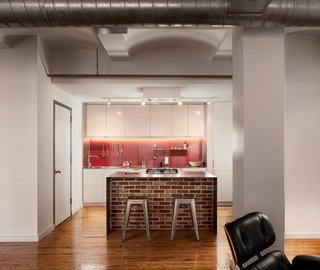 To update the kitchen for this apartment in the Leather District, Chris Greenawalt of Bunker Workshop and contractor Michel Beaudry created a clean-lined space. The space is designed to accommodate the client's busy schedule, which affords him little time for cooking.