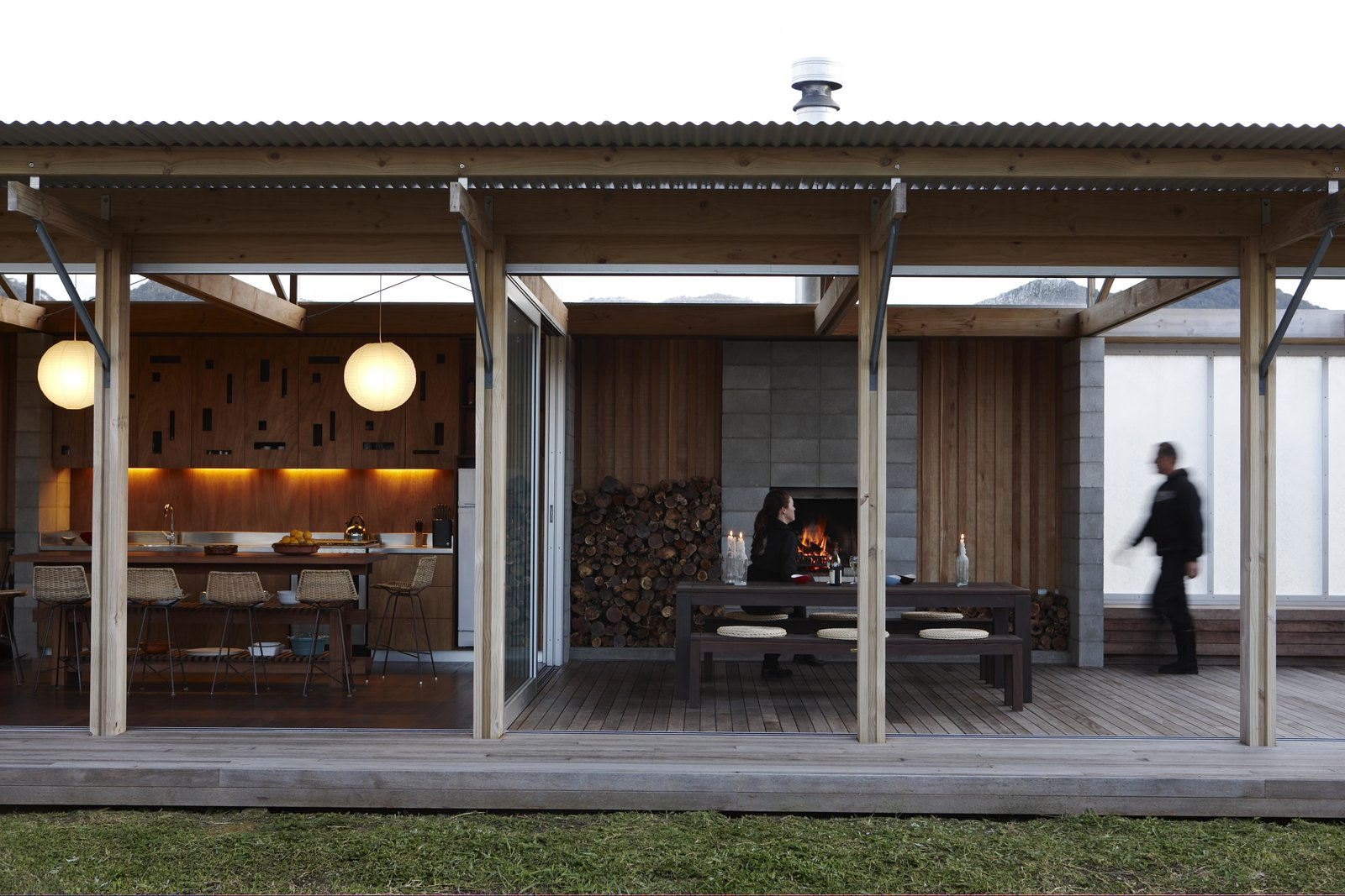 Outdoor, Wood Patio, Porch, Deck, and Large Patio, Porch, Deck Built to go off the grid, this remote beachside cottage can open up completely to the outdoors with its series of movable wall-sized glass panels and screens. Designed by Herbst Architects, the modest New Zealand bach comprises two rectangular pavilions built with mostly natural materials chosen for their durability, texture, and weathering characteristics.  Photos from Off-the-Grid Island House in New Zealand Connects with the Outdoors