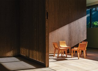 Chairs in the second-floor playroom are by Lievore Altherr Molina for Andreu World. Oak sliding doors can close off the playroom to minimize din.