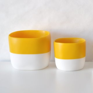San Francisco designer Tina Frey creates modern resin products for the home, using a thoroughly executed design, hand sculpting, and hand casting process. The Striped Square Vessel is a versatile piece that can be used as a bowl, planter, or as storage for small items. The vessel is cast in a two-tone—providing a bright pop of color in its yolk-yellow top half, and a stark white base that is a nice counter to the saturated upper half.