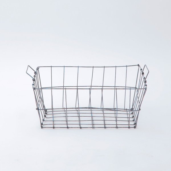 This Market Basket from designer Yumiko Sekine is roomy and accommodating, and is designed to fit up to size A4 paper if used on a desk or in an office. The versatile basket can be used in myriad ways, from holding cloth napkins or kitchen accessories, organizing bathroom products, storing magazines in a living room, or even to hold slippers at an entryway or bedside.