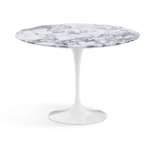 """Part of the Pedestal collection introduced by Eero Saarinen as an answer to """"the ugly, confusing, unrestful world"""" that lay beneath the surfaces of chairs and tables, this 42"""" round dining table comes in both Arabescato marble (shiny or matte finish), and a white laminate."""