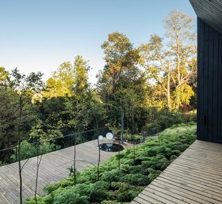 The lower terrace, which features a hot tub, is farther down the hill to immerse its users in the landscape.