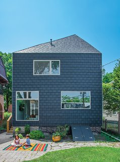 A couple in Evanston, Illinois, asked John Issa of Perimeter Architects to add on a two-story, 650-square-foot addition to their traditional farmhouse. The new volume is clad in composite slate siding by Inspire Roofing Products; the windows are Pella.