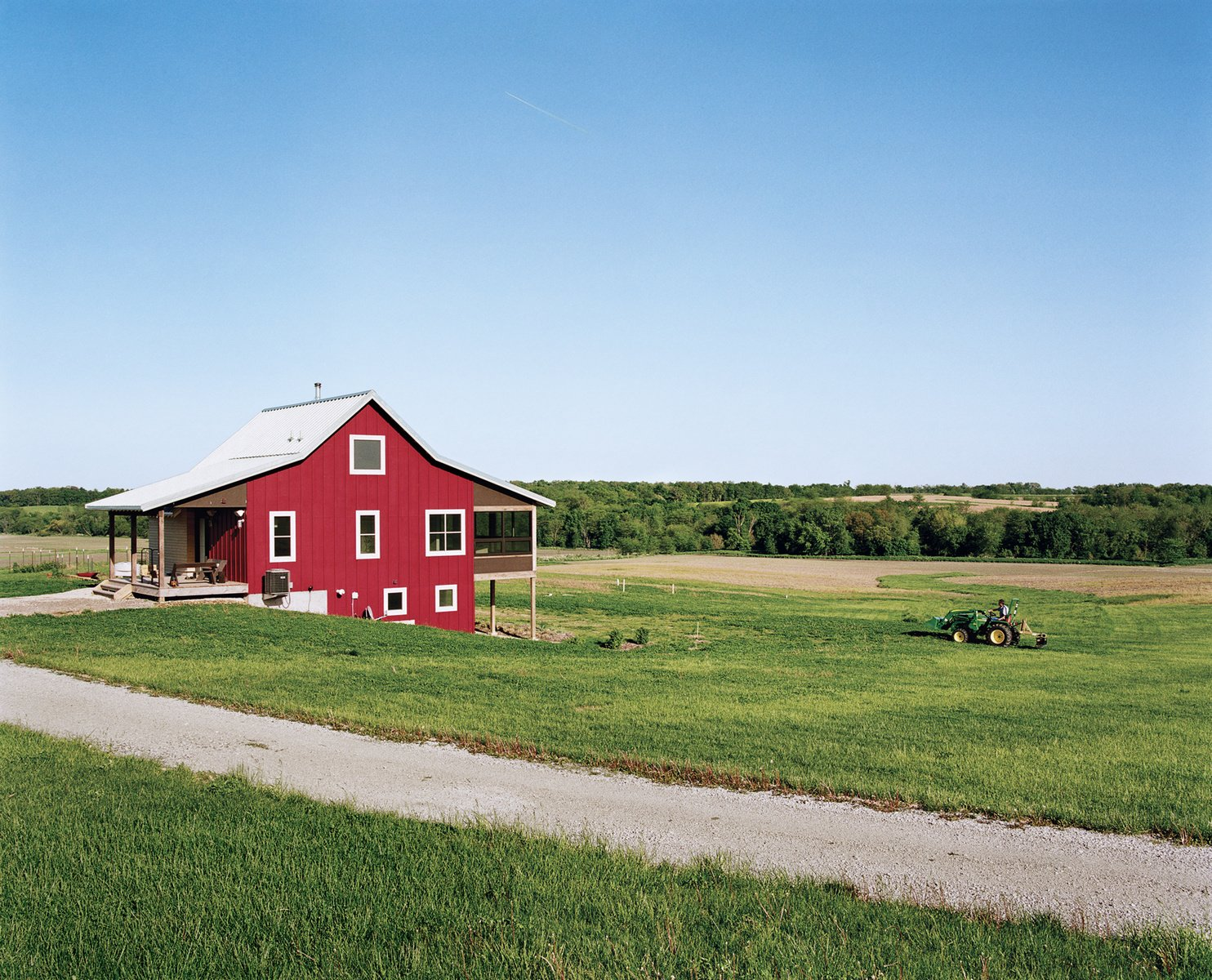 Geoff and Joanna Mouming's compact modern farmhouse is the first permanent structure at Yum Yum Farm in Wellman, Iowa. On the field that stretches out before it, organic vegetables will soon make attentive farmers of the Moumings. Photo by: Mark Mahaney  Photo 19 of 20 in 20 Modern Homes From the Midwest from Modern Homes Across the American Midwest