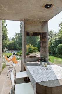 Smitten from the start with a 1970s concrete villa in rural Belgium, a resident and her designer embark on a sensitive renovation that excises the bad (carpeted walls, dark rooms) and highlights the good (idyllic setting, statement architecture).