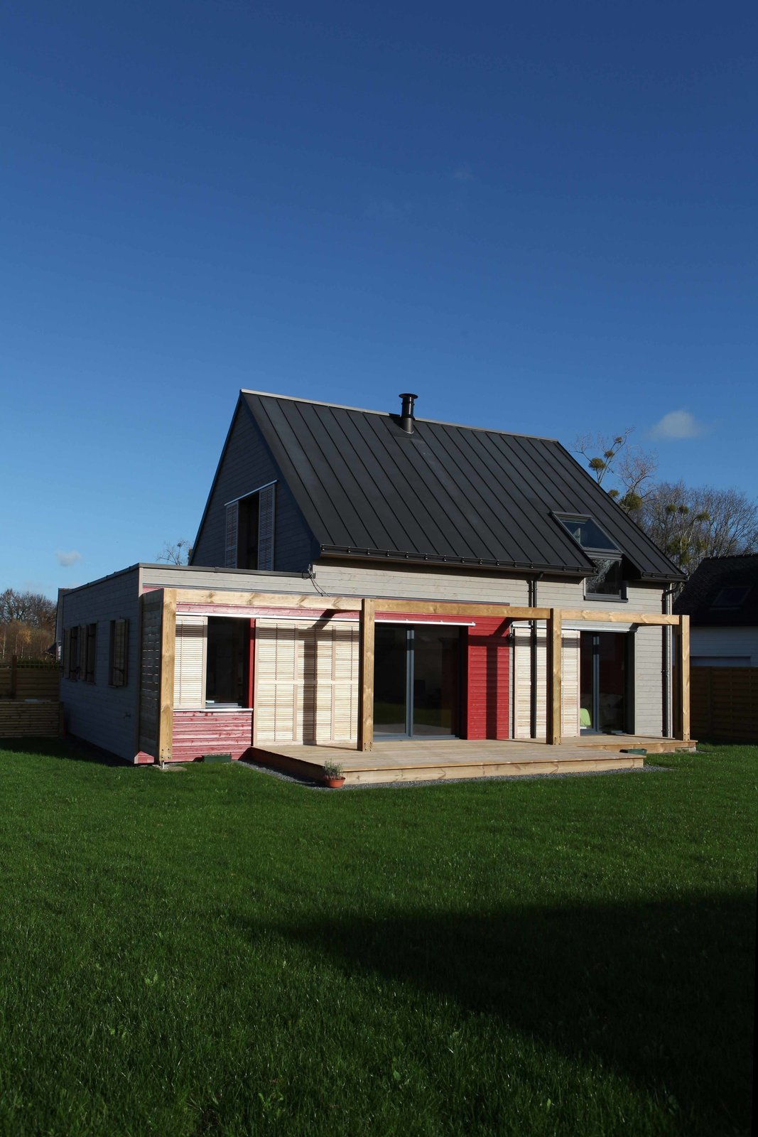 A solid wood exterior retains heat in the winter and keeps the house cool in summer.  Fantastic Examples of French Living by Allie Weiss