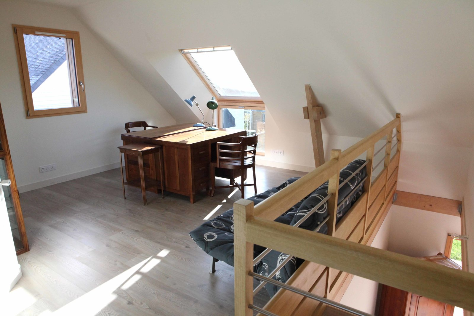 The building's interior is still a work in progress, but the residents plan to incorporate as many natural wood elements and low-impact design details as possible as they furnish. The loft's floor will eventually be finished with floating parquet.  Photo 4 of 7 in A Cozy, Well-Sealed Cottage in Northwest France Goes Green