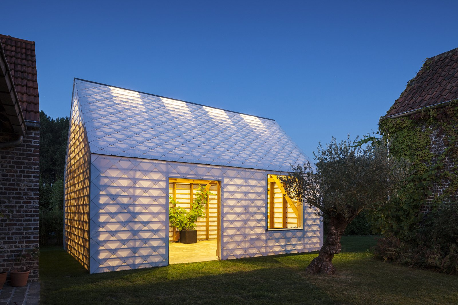 Exterior and Cabin Building Type The 484-square-foot room offers a cool respite from summer sun and a warm place to relax in winter.  Inexpensive Gabled Garden Shed in Belgium by Diana Budds from Bold and Belgian Dwellings