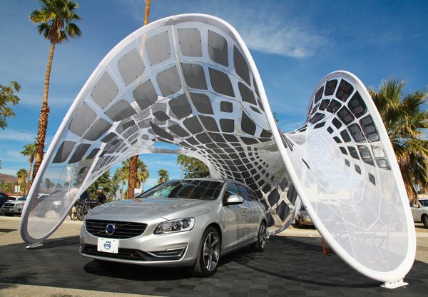 """The """"Pure Tension Pavilion"""" made its U.S. debut this weekend as part of Dwell and Volvo's activation at the Modern Living Expo and Prefab Showcase. Designed by Alvin Huang, this a free-standing tensioned membrane structure is a rapidly deployable and portable solar charging station designed to power up the Volvo V60 Plug-in Hybrid, the world's first Diesel Plug-in Hybrid."""