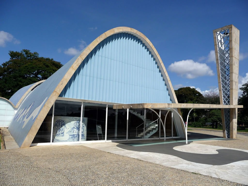 After starting his career by apprenticing then collaborating with Lucio Costa, Oscar Niemeyer made his mark with this modernization project. The highlight is the Church of St. Francis of Assisi, a revolutionary modernist touchstone with a parabolic roof and polychromatic tiles that was such an unexpected departure from previous chapel designs, one politician suggested demolishing it.  Photo 2 of 11 in Design Icon: Oscar Niemeyer