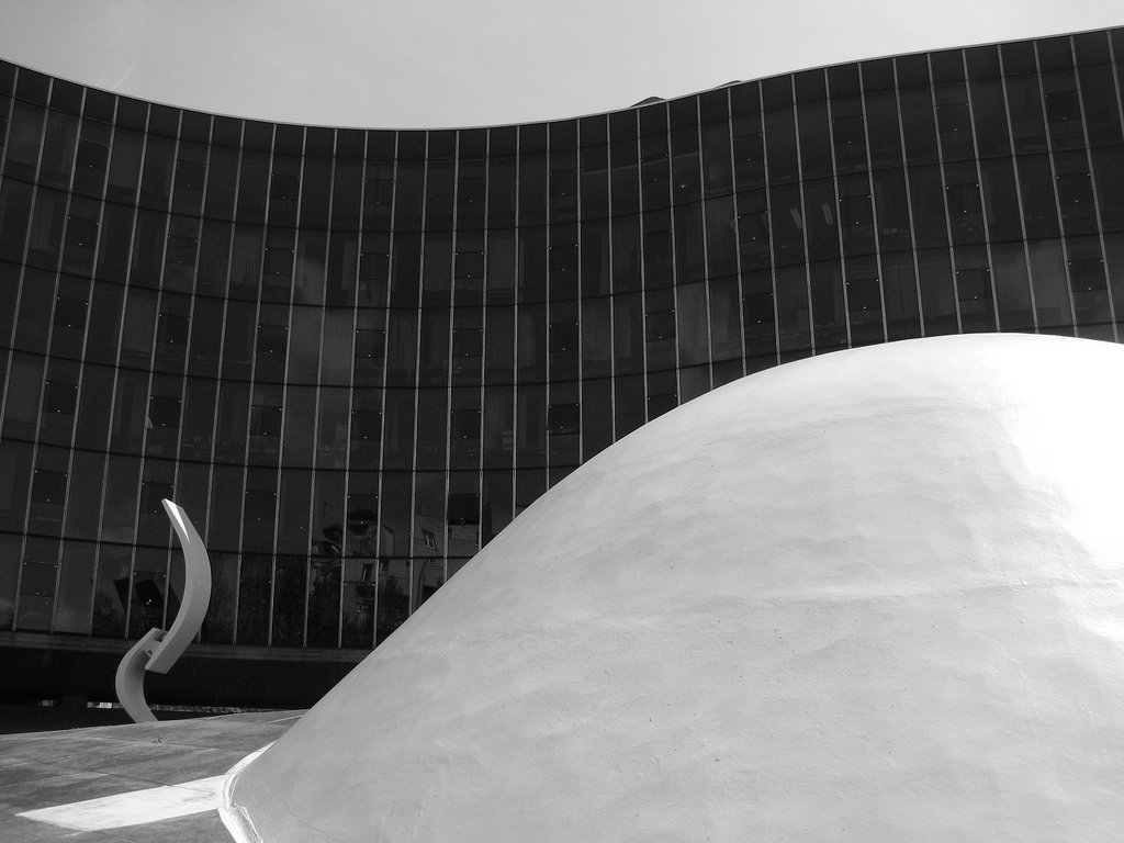Built during Niemeyer's exile from Brazil for no charge—that's a committed member of the Party, for you—this standout structure in a Paris filled with stylish grandeur makes powerful statements with modest touches, such as the wavy glass facade, domed cupola and textured concrete walls.  Photo 9 of 11 in Design Icon: Oscar Niemeyer
